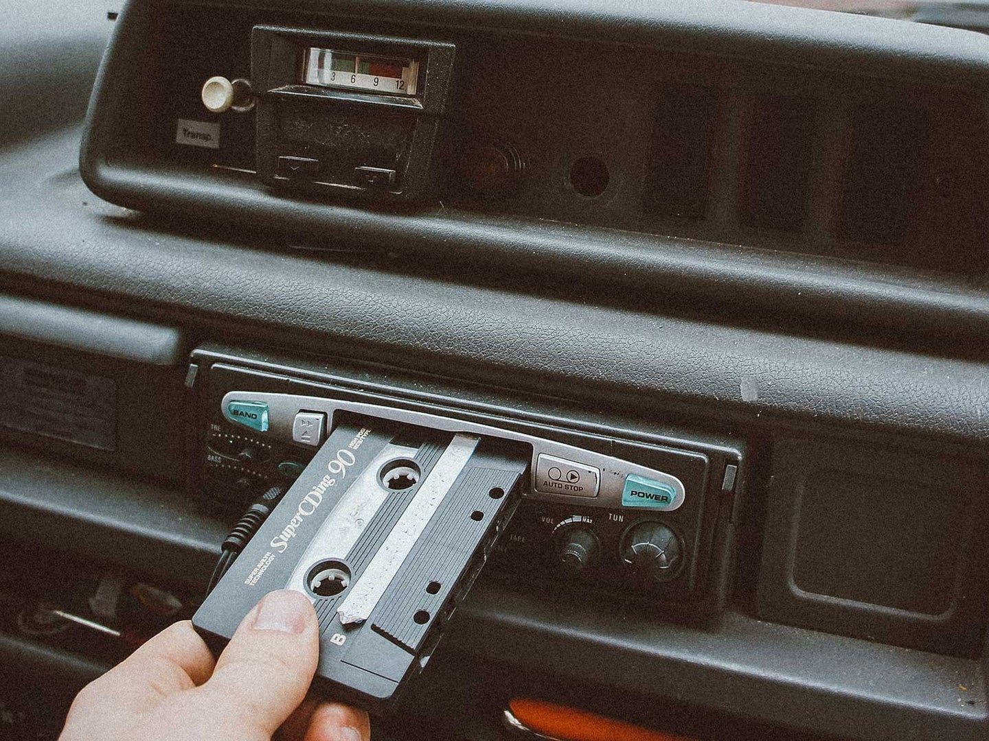 Car cassette tape playing in car.