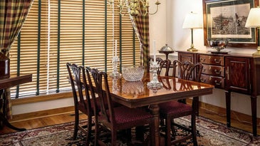 Dining room with rug.