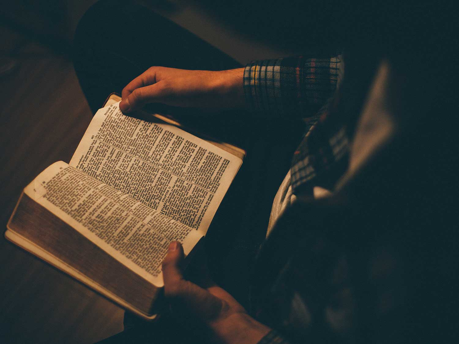 Reading Bible with light.