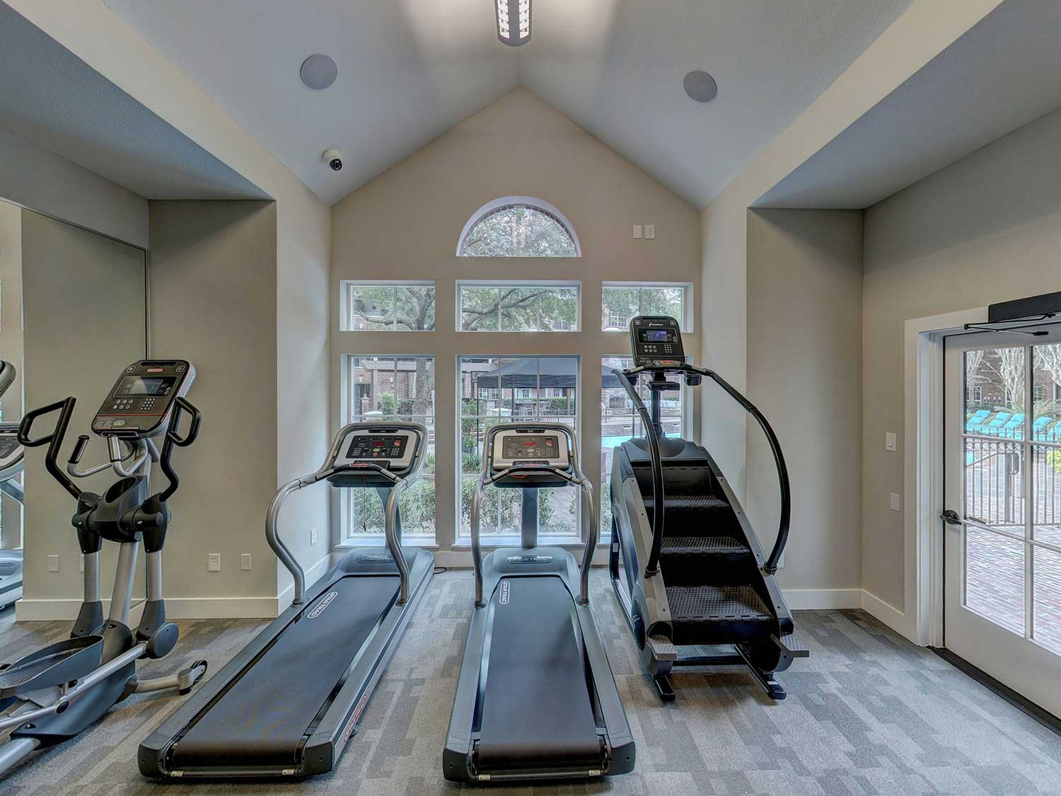 Treadmills and at home workout equipment in home gym.
