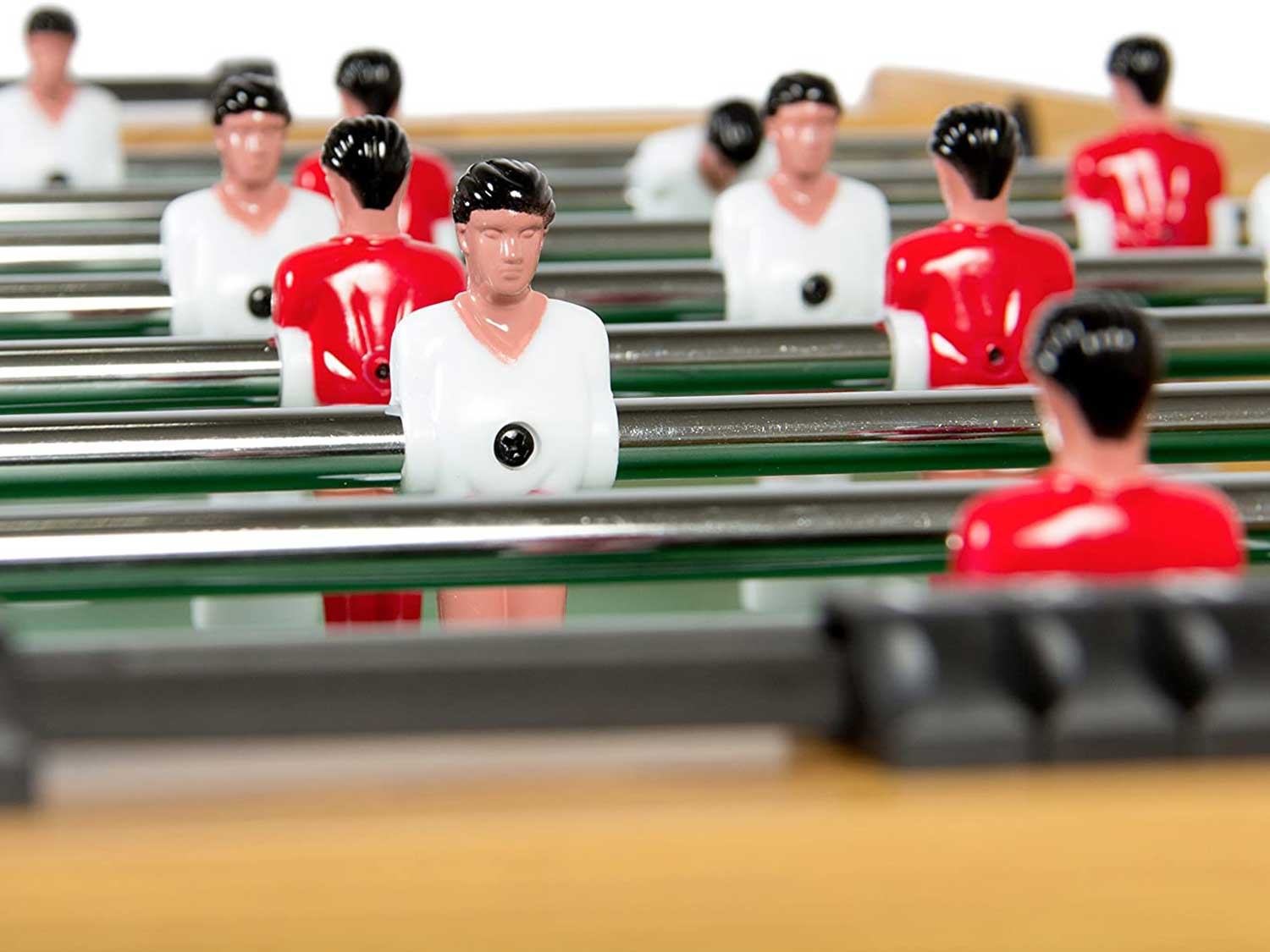 Close-up of foosball table players.