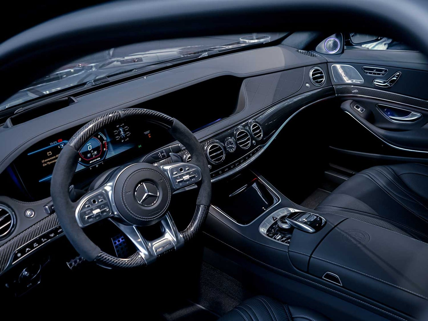 Black and silver Mercedes Benz front seats.