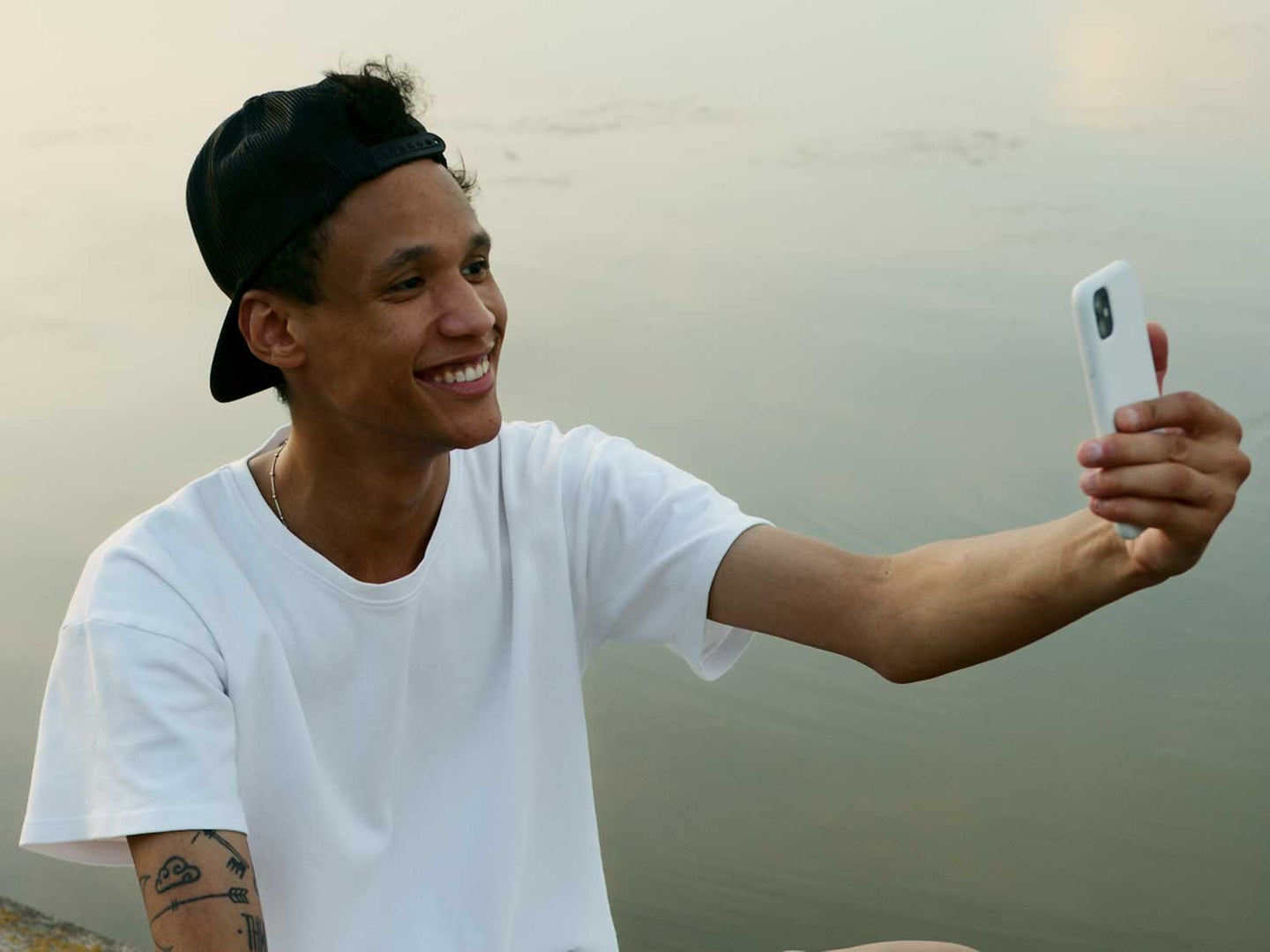 Man taking selfie with iPhone.