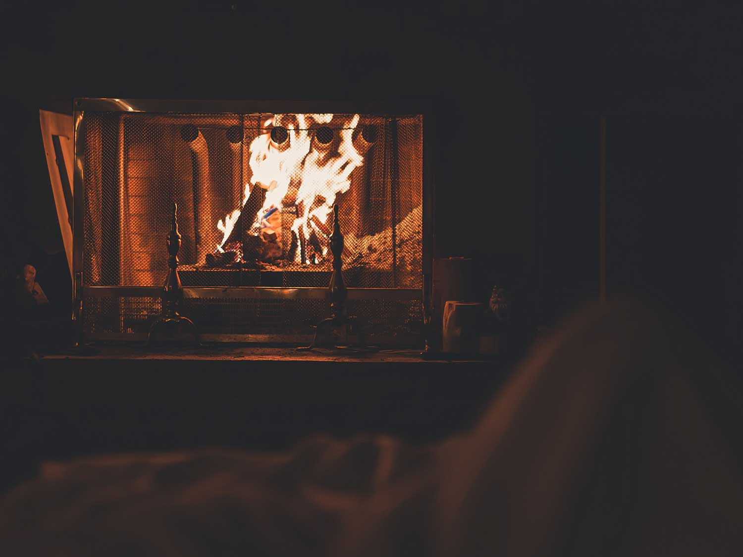 Wood burning in fireplace.