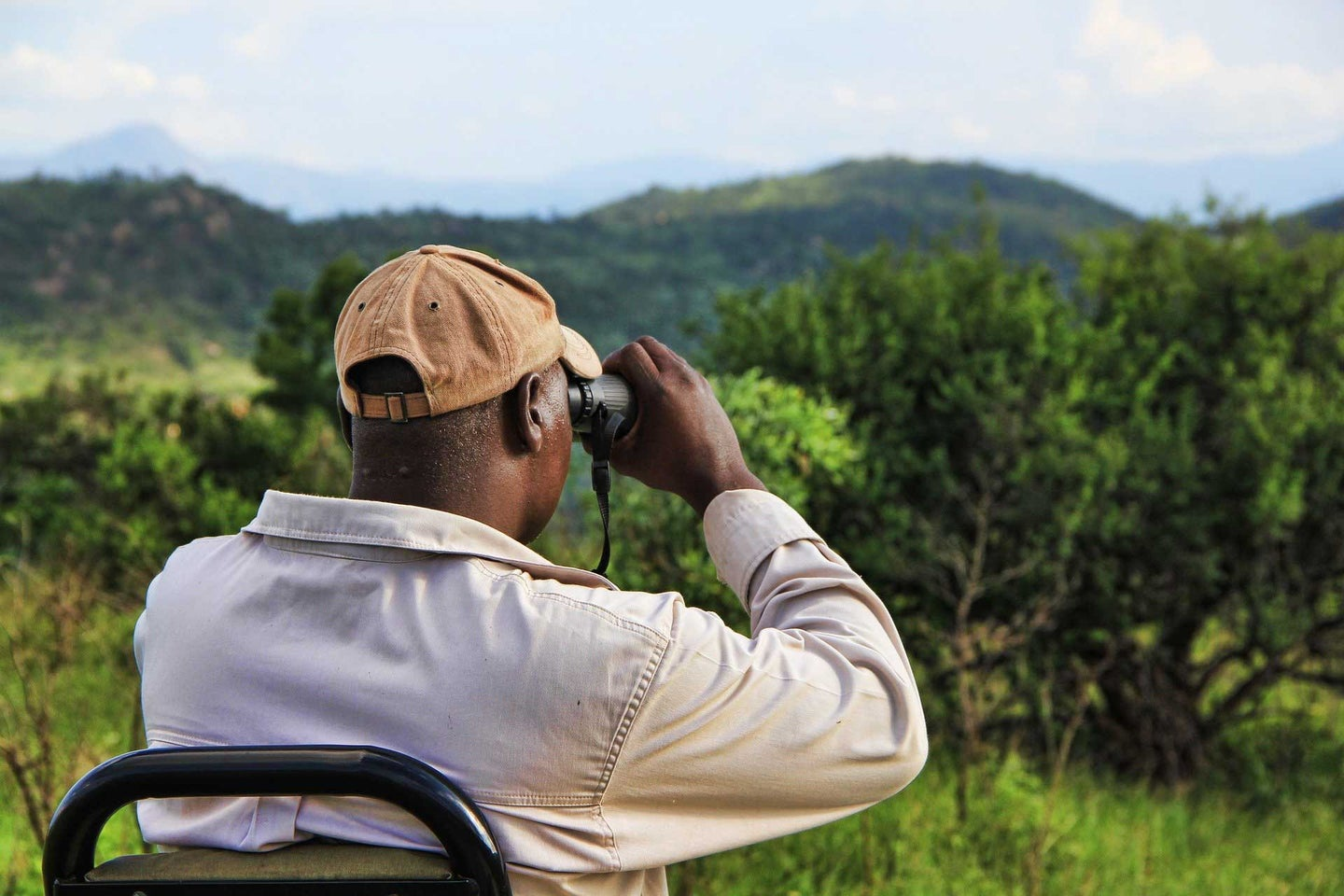 Man looking out over landscape with binoculars