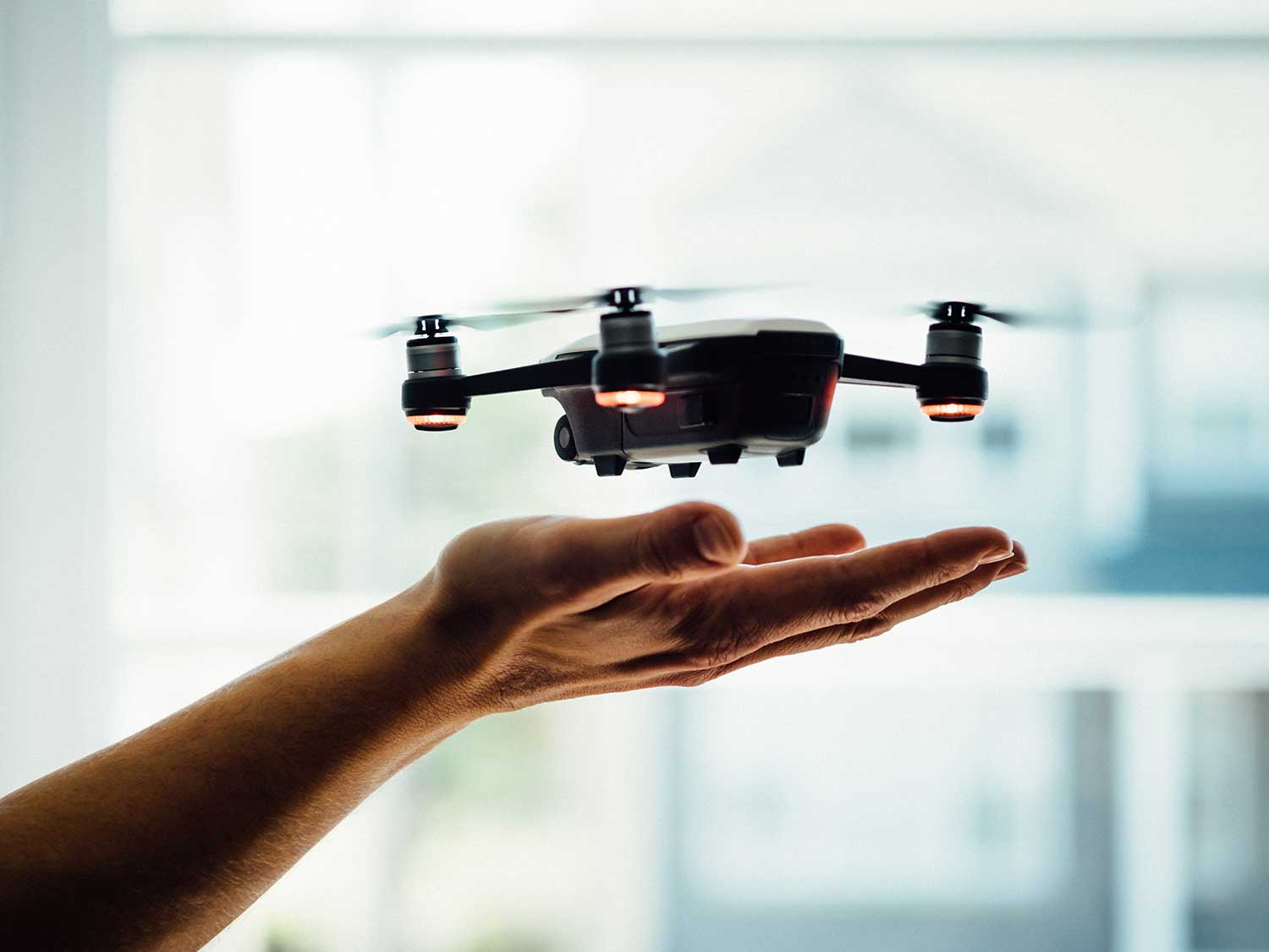Drone hovering over hand.