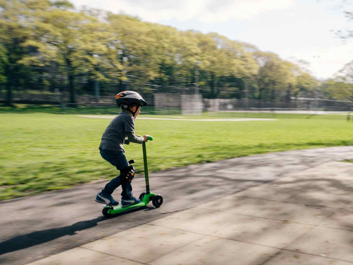 Kid riding scooter