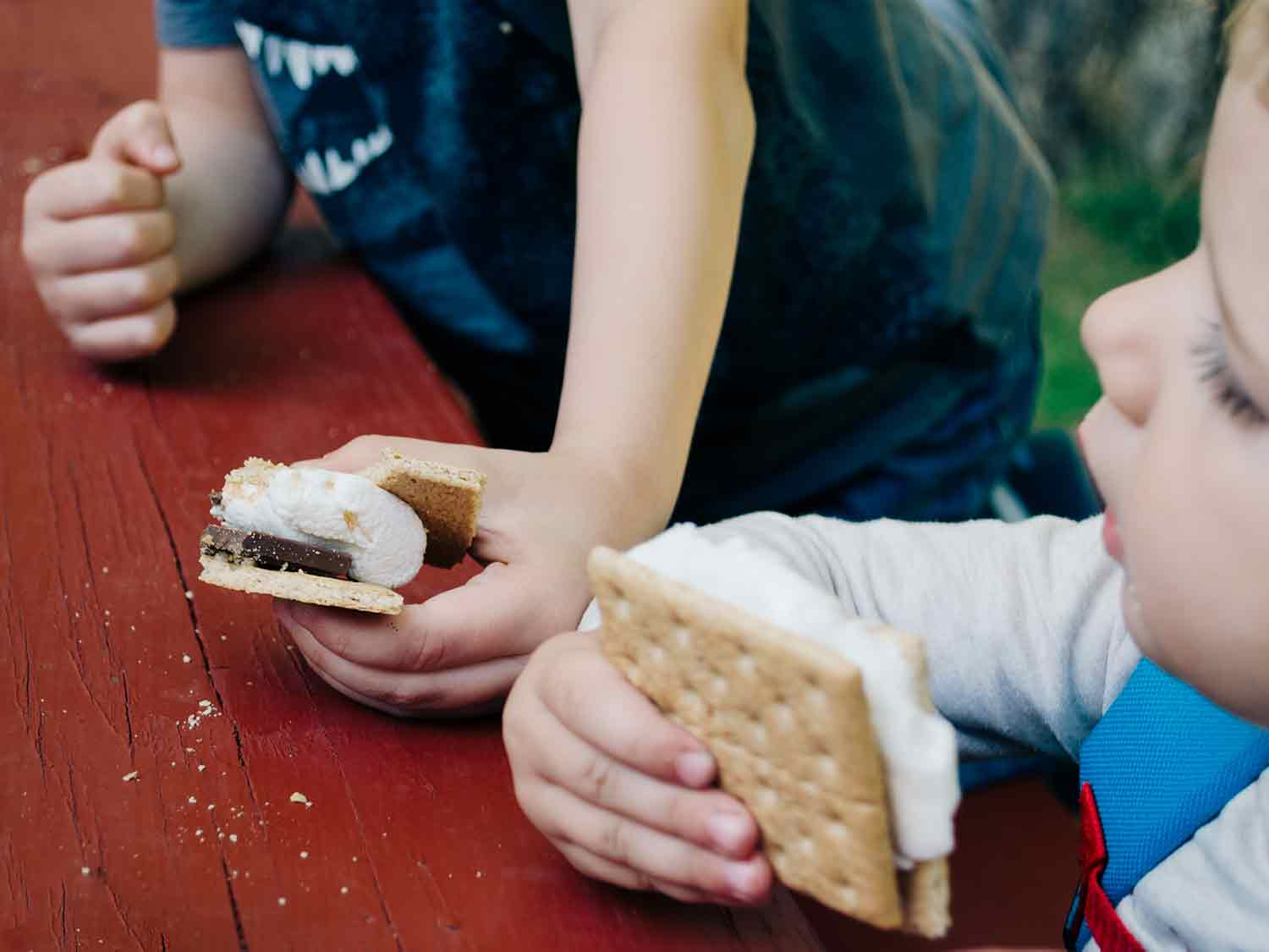 Kids eating s'mores.