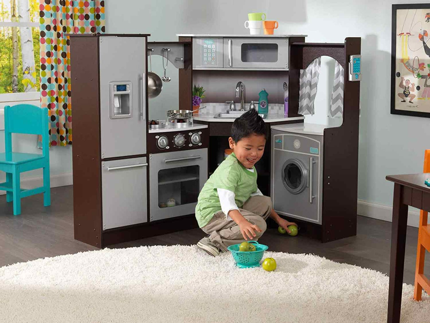 Kid playing with kitchen set