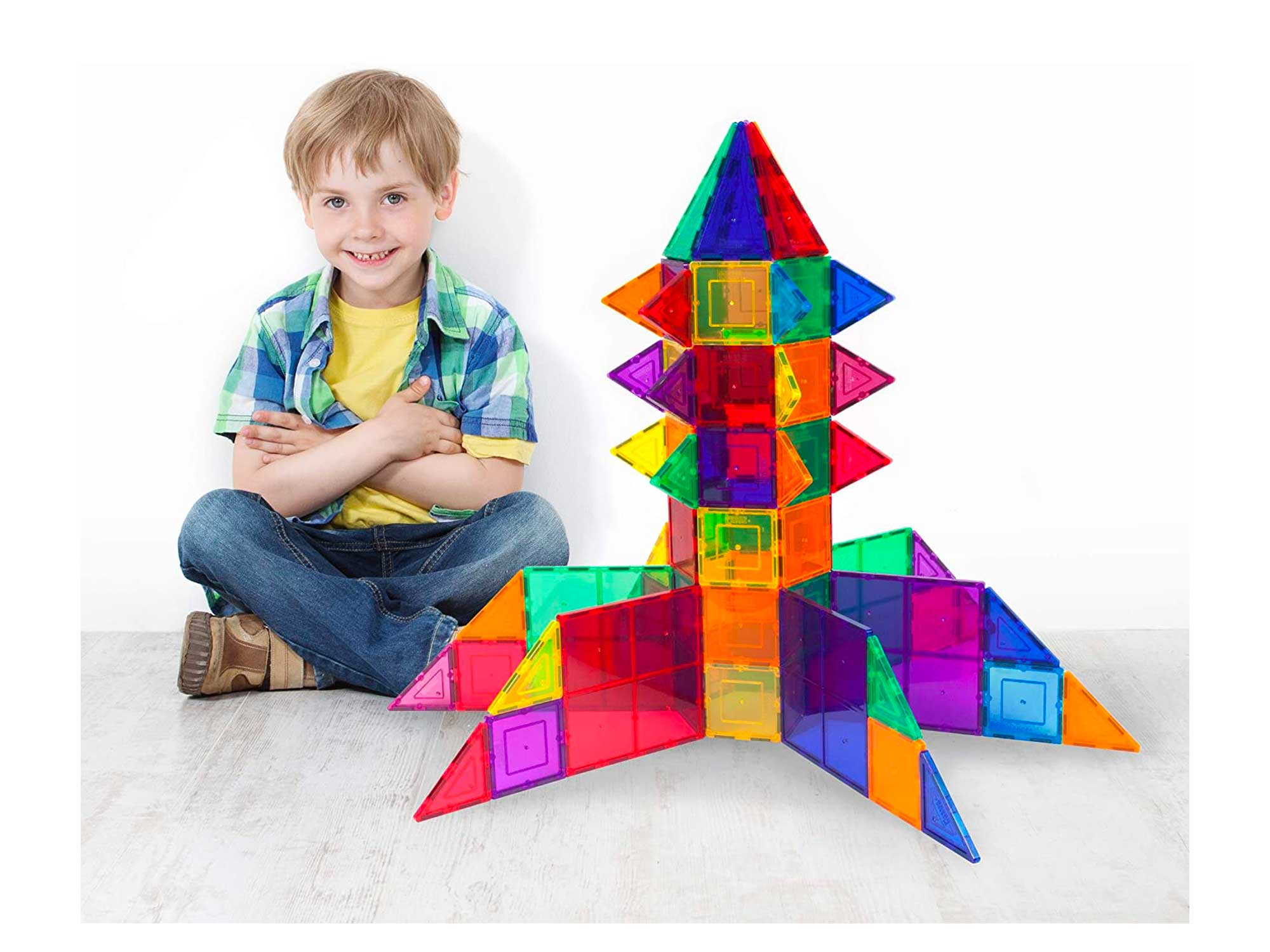 Little boy with a building toy