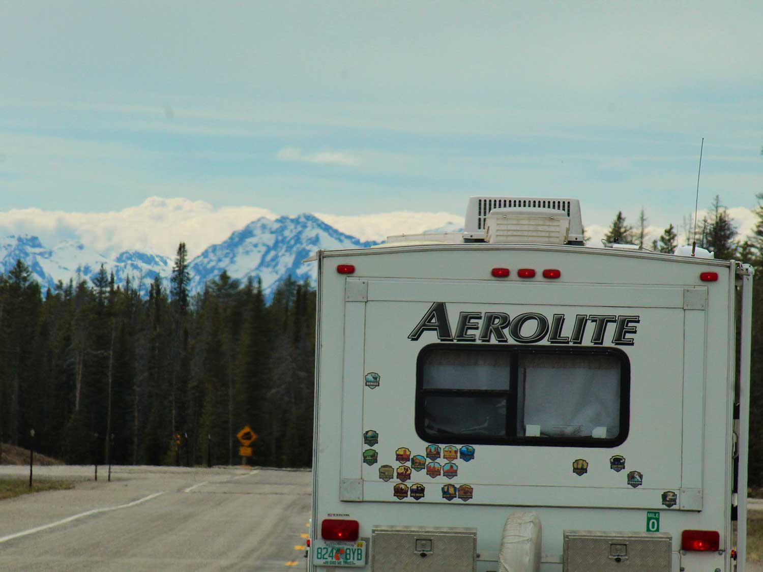 RV on the road with GPS towards mountains.