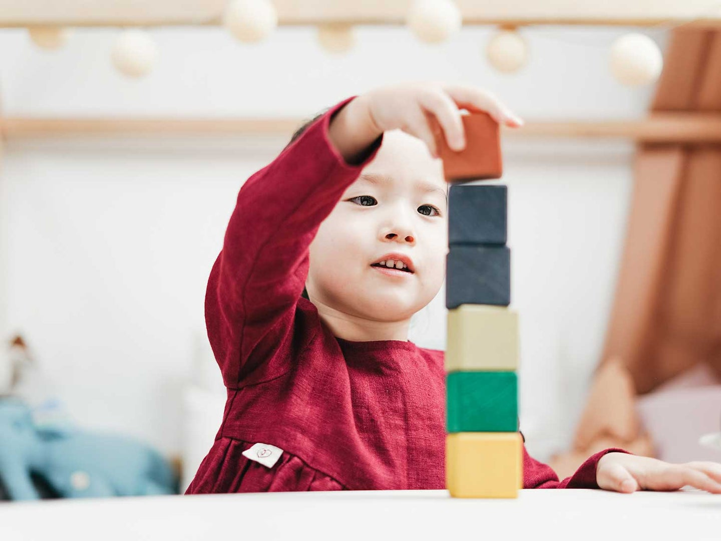 Boy playing with wooden blocks.
