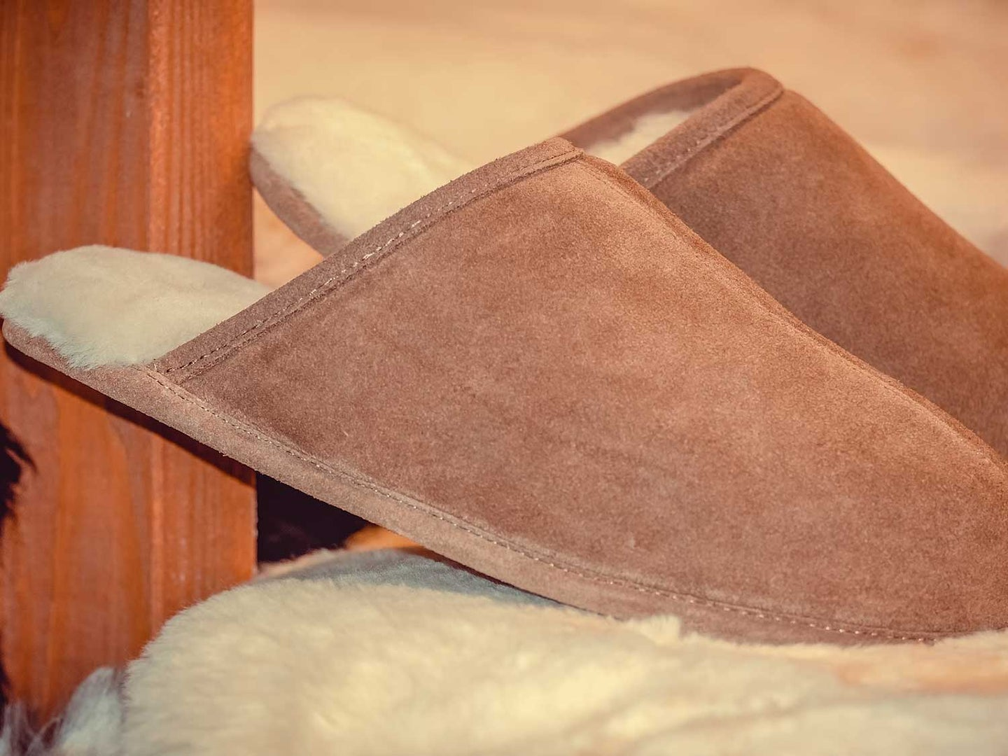 Slippers on bed.