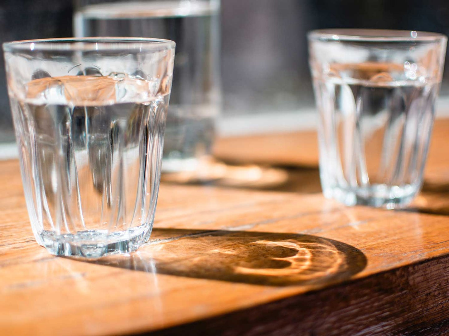 Water glasses filled with filtered water from refrigerator.