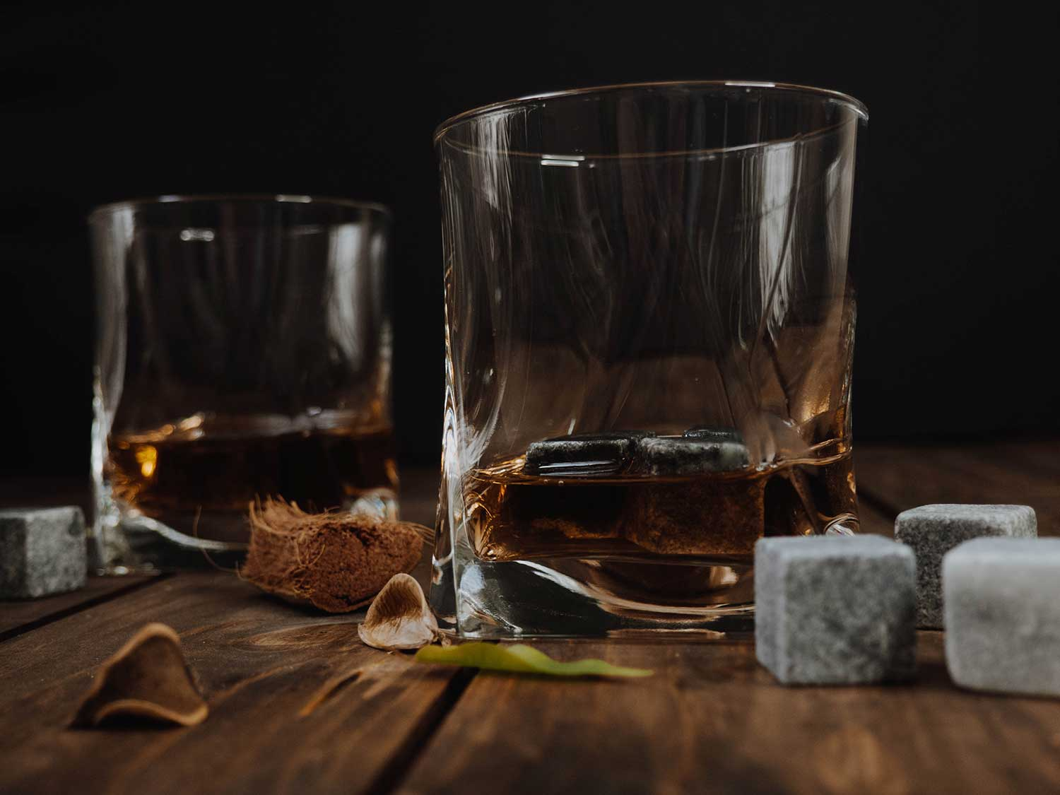 Whiskey in glasses with whiskey stones.