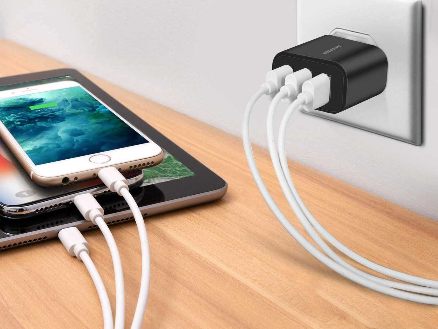 Charging phone and tablet with USB wall charger.