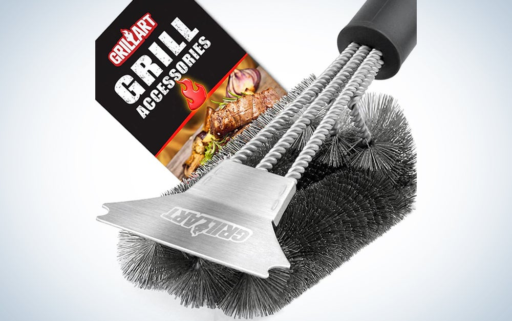 silver and black grill brush with label