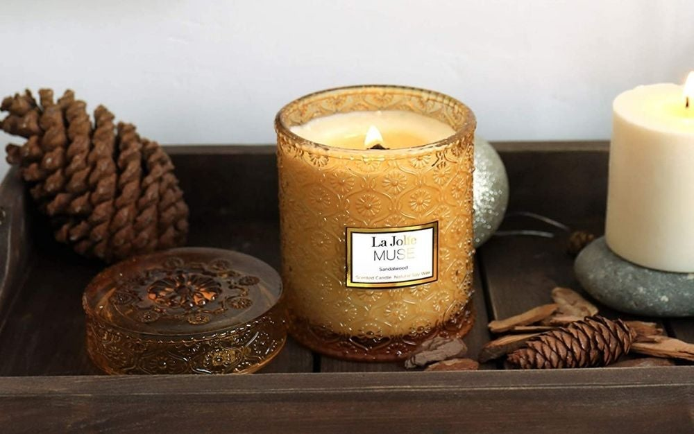 Scented Candles standing in a wooden table