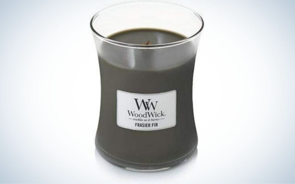 Candle in a transparent glass container and white label