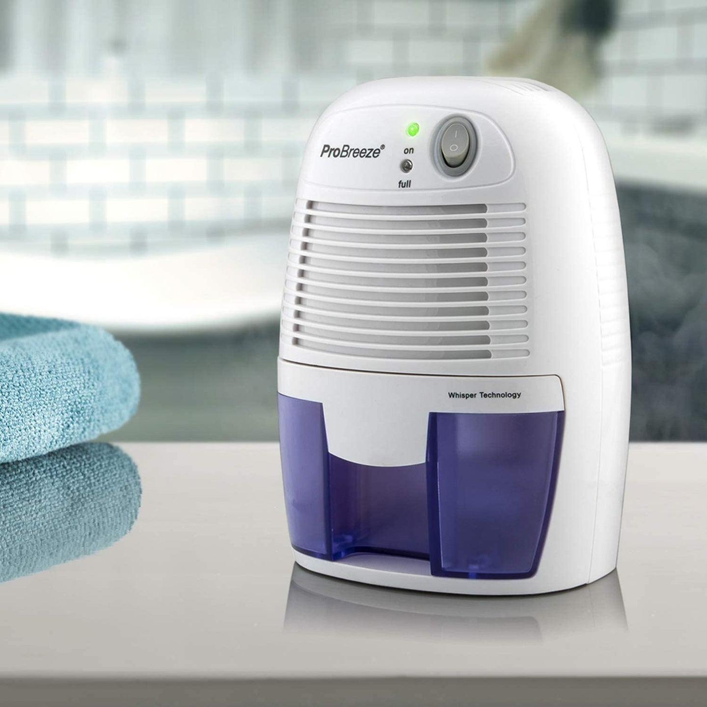 white and purple dehumidifier on a counter