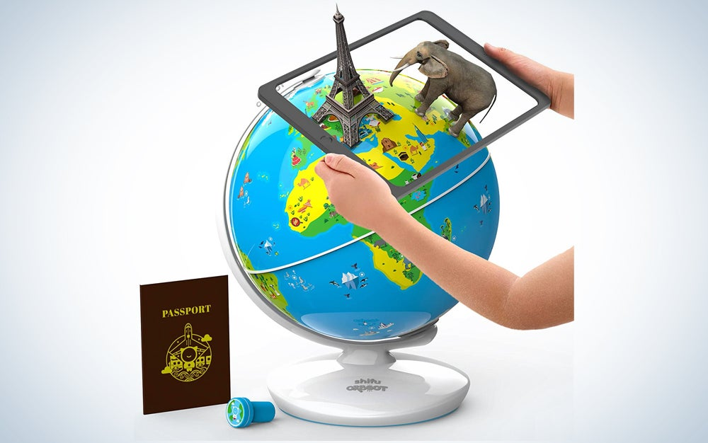 iPad held above a globe with a 3D Eiffel Tower and elephant displayed on the tablet