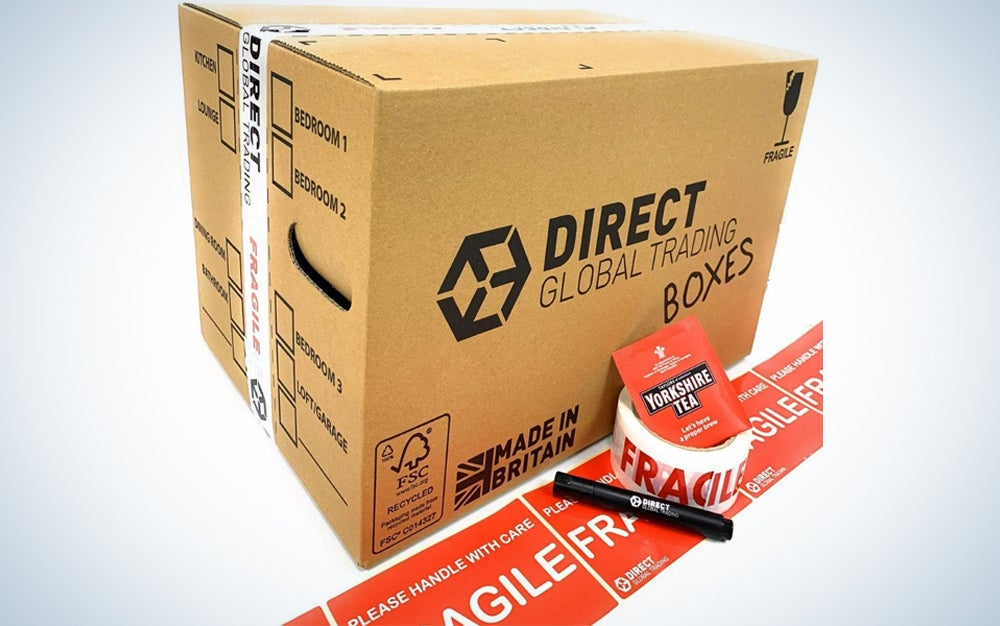 cardboard box with fragile stickers, tape, and a black pen