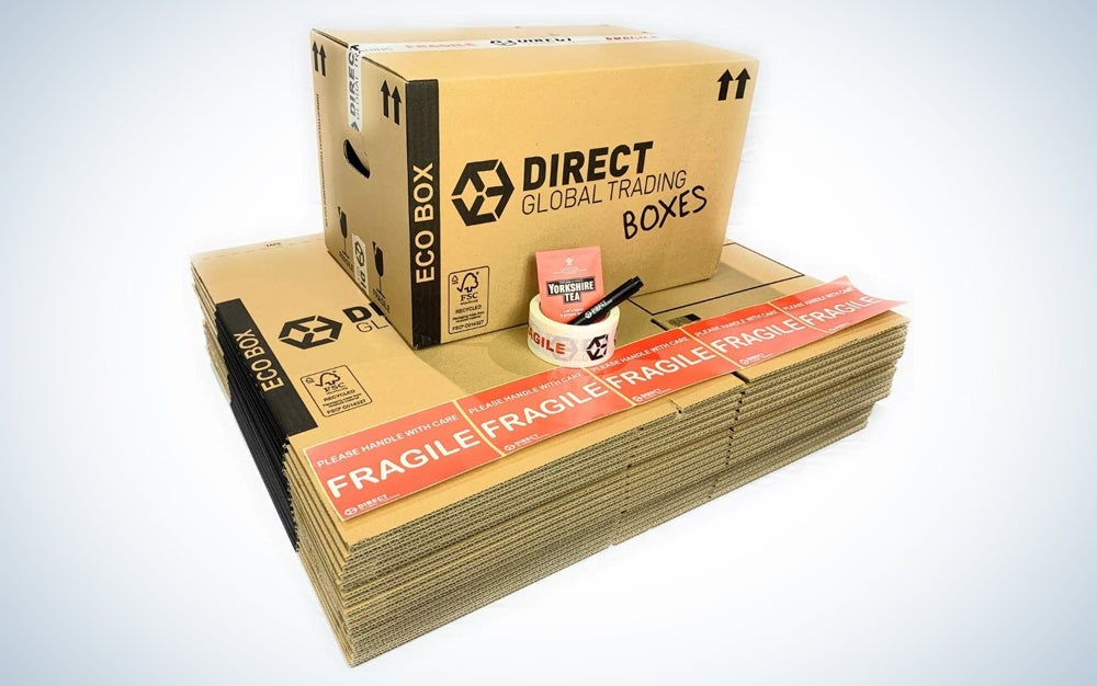 stack of boxes with fragile stickers, roll of tape, and a set up box on top