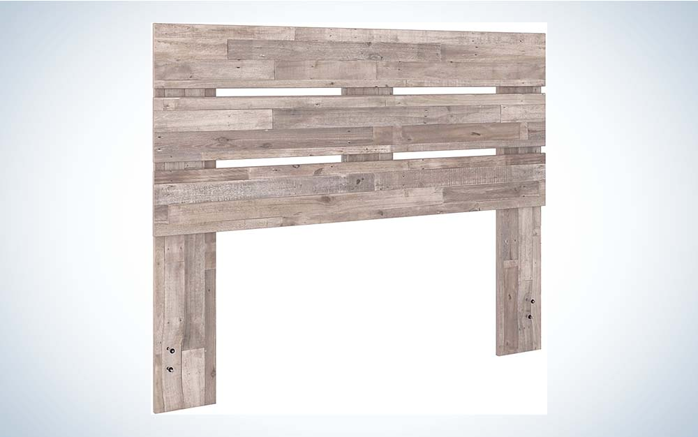 The Signature Design by Ashley Neilsville Butcher-Block Panel Headboard is the best value queen-sized headboard.