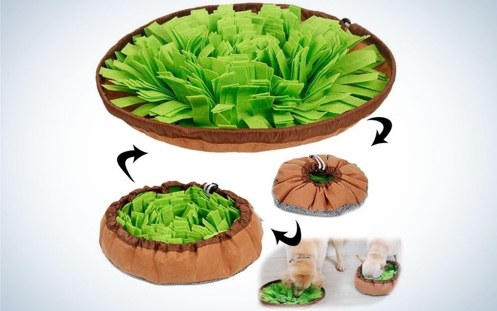 A Pet Snuffle Mat with green leaf on the top and surrounded by a piece of brown holder.