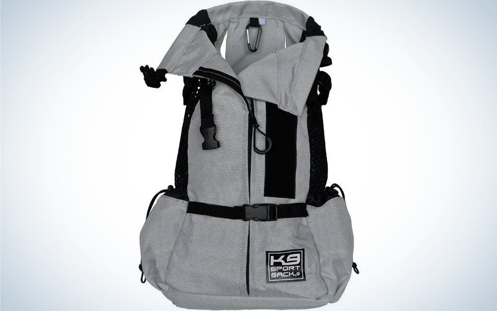 Front facing grey backpack with black straps and stripes.