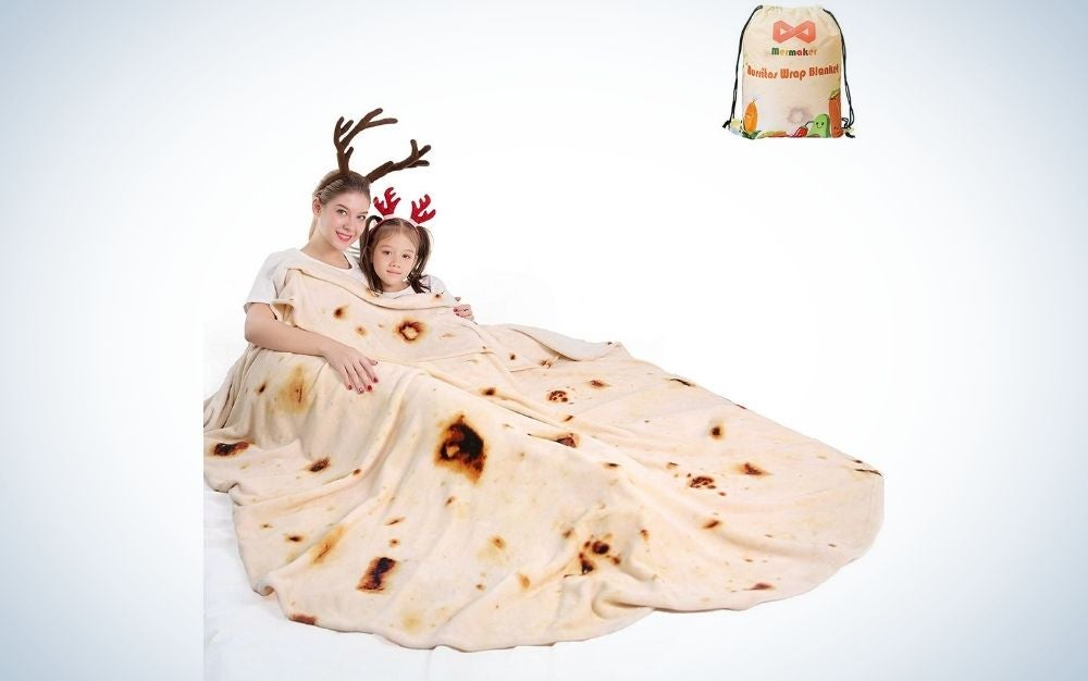 A young woman and girl wrapped in a blanket like a burrito and with a bag on top in the photo with description burritos wrap blanket.
