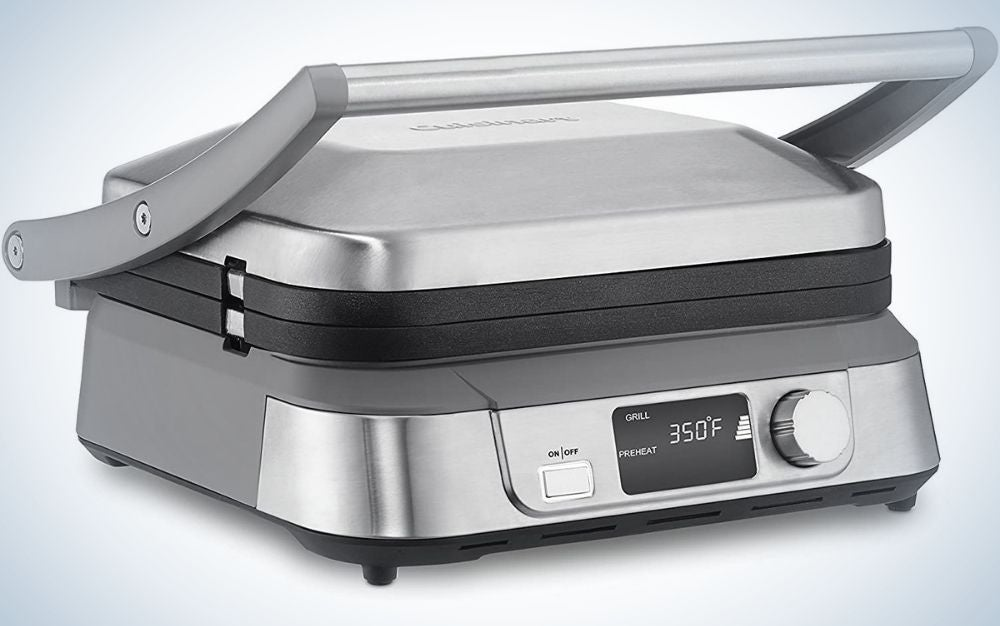 A silver Cuisinart electric griddler with temperature and timer into a small black box in front of the panini press.