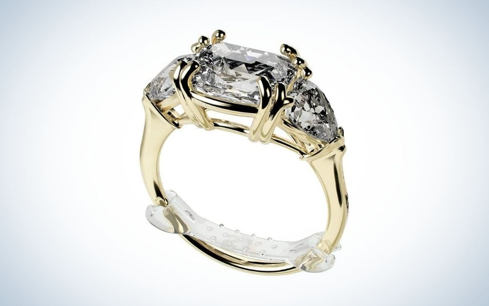transparent ring size adjusters on a wedding ring