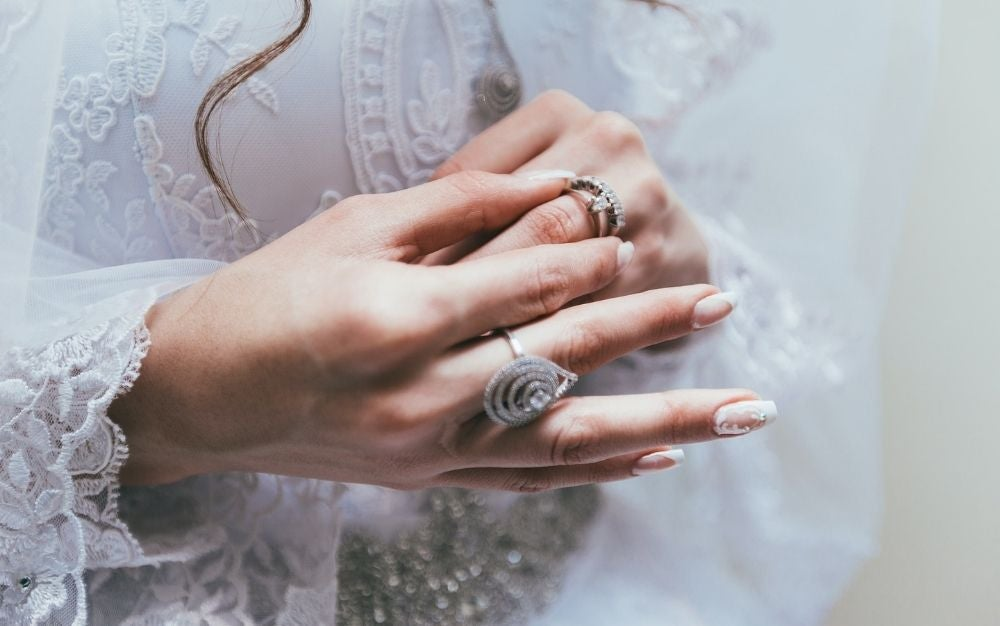 3 ring size adjusters making the rings fit perfectly on the bride's fingers