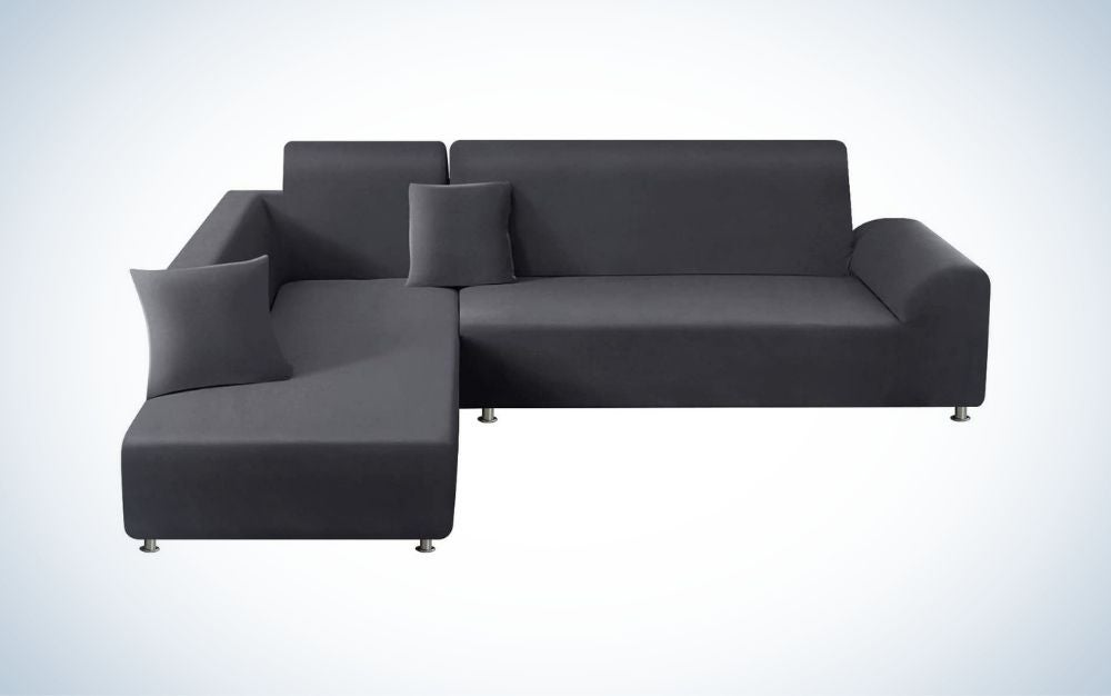 A dark grey sectional couch slipcover
