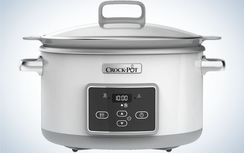 Grey digital slow cooker pot with transparent lid from front.