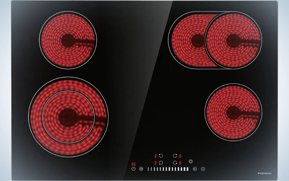 A solid black plate with four fiery red spheres and under them some numbers and thin lines.