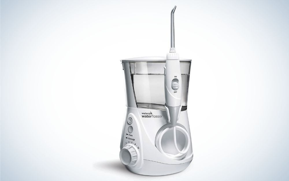 White professional water flosser with electric cord