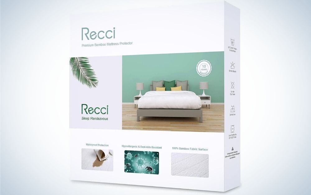 A white box with a picture in it and in the center the figure of a large bed with white covers and pillows.