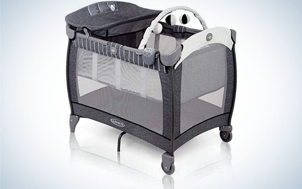 A four wheel bassinet for newborns in a grey and white color and with being transparent in both sides.