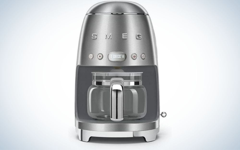 A coffee machine all in silver and with some buttons on the top and a glass pot inside.