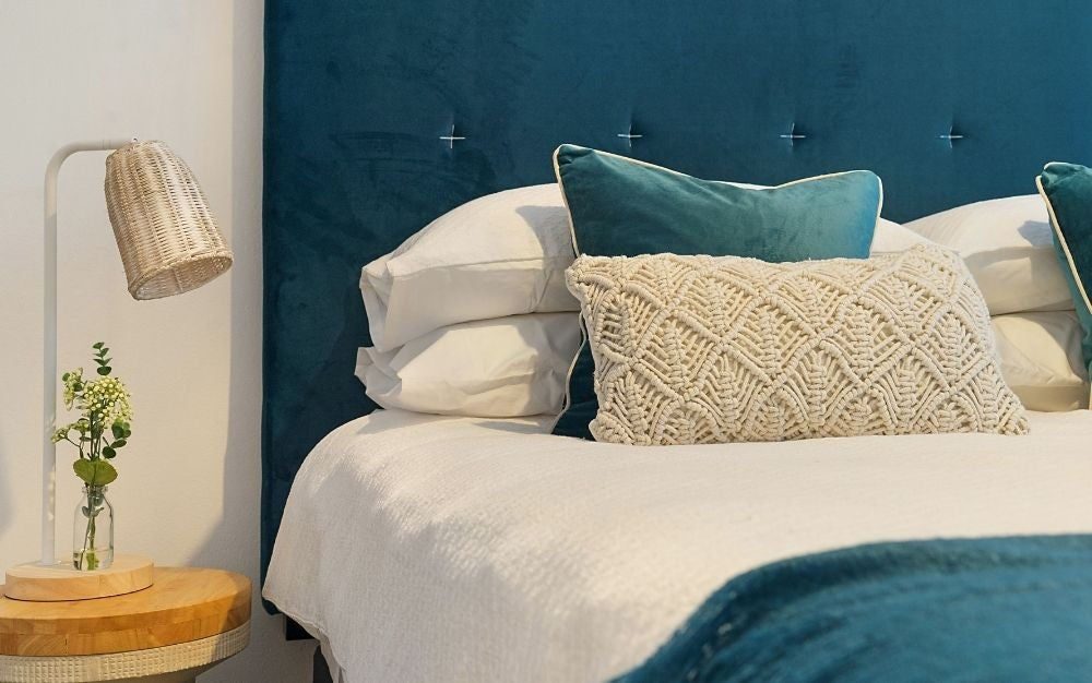Bedroom with blue bed frame, mattress, and pillows