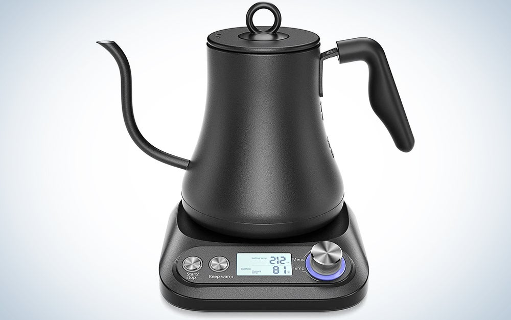 black gooseneck kettle on an electric base with temperatures displayed