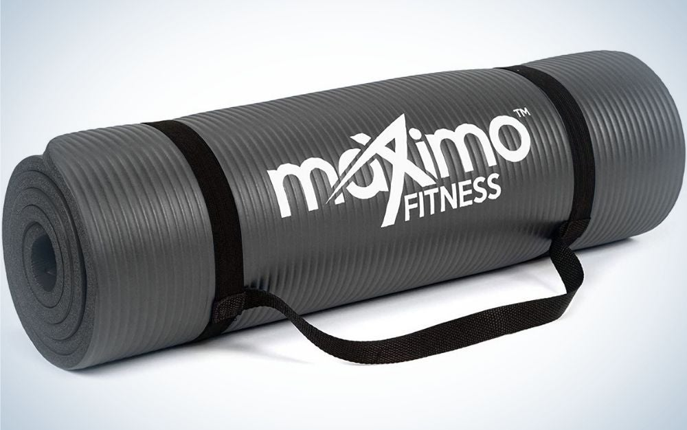 A yoga mat all black assembled and with the brand name on it.
