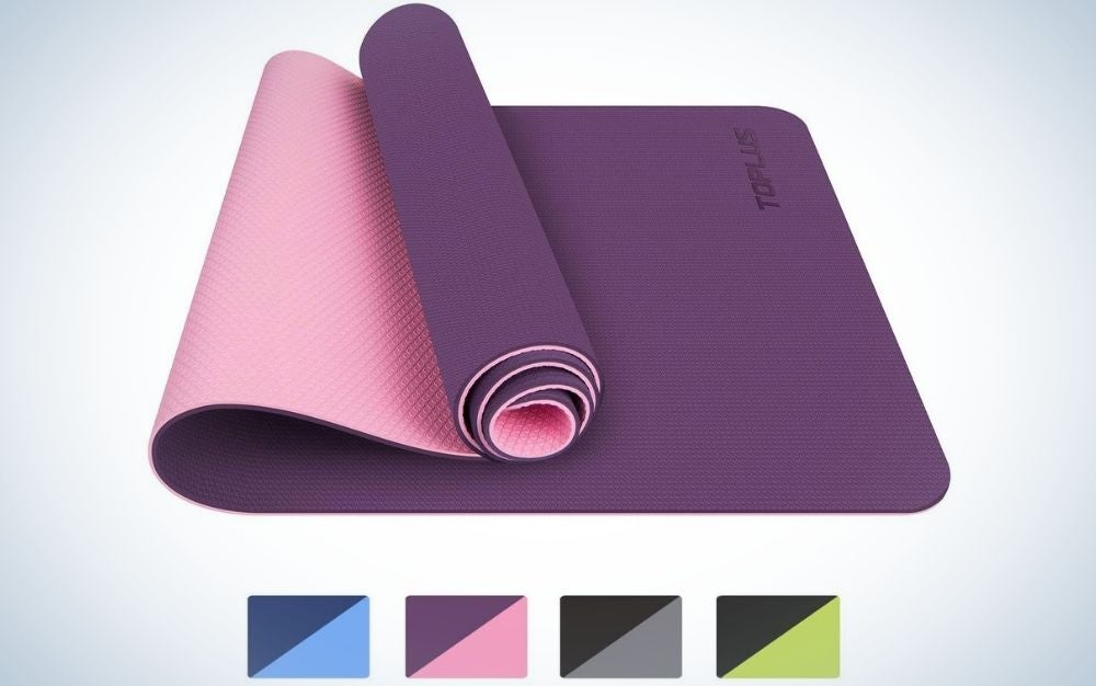 A yoga matte purple from above and pink from below, half encased and half light and with 4 other colors underneath.