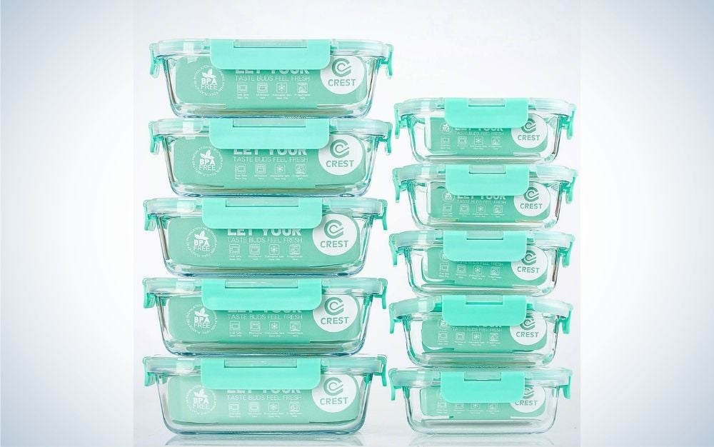 Some transparent glass food containers that stand on top of each other and are all with pastel blue lids.