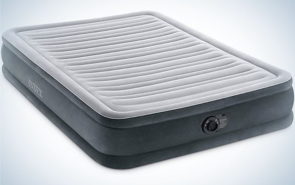 A large and thick air mattress which is dark gray and white gray and has thick stripes on the top and a black lid on the side.
