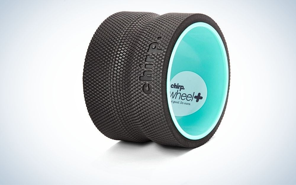 A wheel which is large and wide with a black layer from above and mint color from the inside as well as with its brand name on the black color.