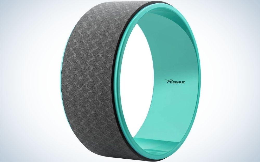 A wheel with a thin tread which on the inside has the brand name and is mint color and from above black color with small triangles in it.