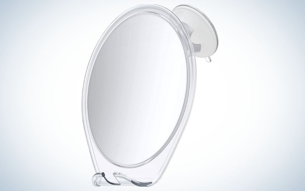 Oval, white, fogless shower mirror with razor holder and swivel
